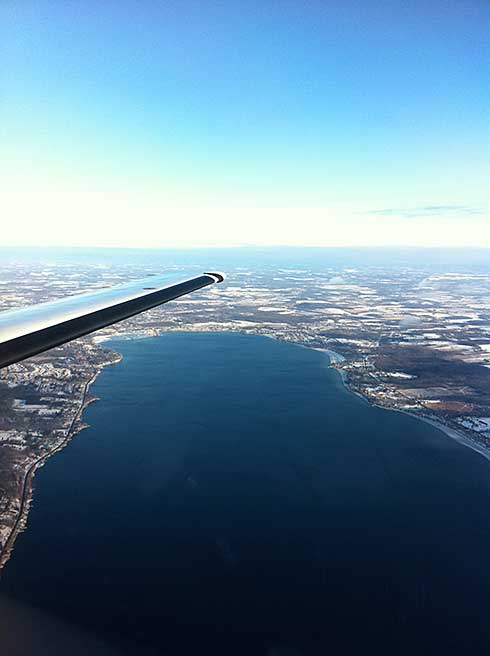 Aerial wintertime photo of Canandaigua Lake and Canandaigua New York