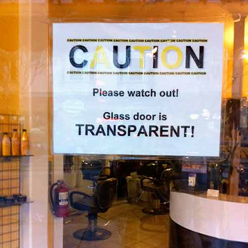 photo of stupid dumb sign that says that glass is transparent