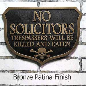 Humorous No Solicitors Sign threatens trespassers with being killed and eaten if they enter your property.